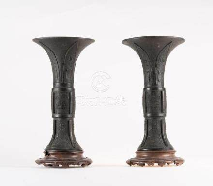 Chinese Art A pair of Gu shaped bronze vases decorated in th