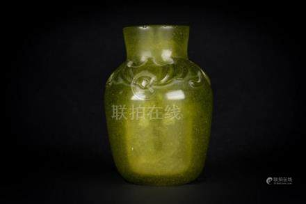 Chinese Art A small green glass vase moulded with bats and b