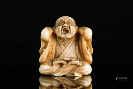 Japanese Art An ivory netsuke depicting a scholar. Signed at