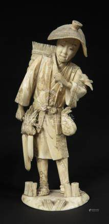 Japanese Art An ivory okimono depicting a farmer, signature