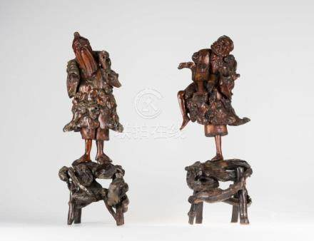 Chinese Art A pair of root wood sculptures depicting fisherm