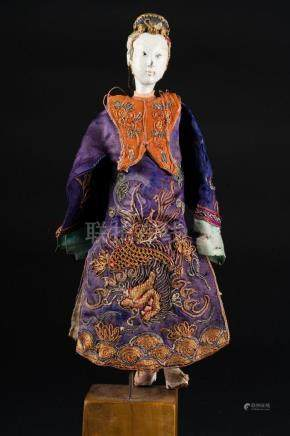 Chinese Art A wooden lacquer and silk doll China, 19th-20th