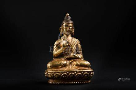 Chinese Art A gilt bronze figure of Amoghasiddhi Sino-Tibet,