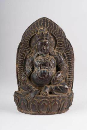 Himalayan Art A Jambhala wooden figure Tibet, 19th century