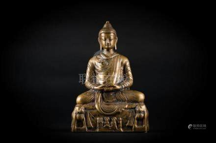 Chinese Art A bronze figure of seated Buddha Northern India,