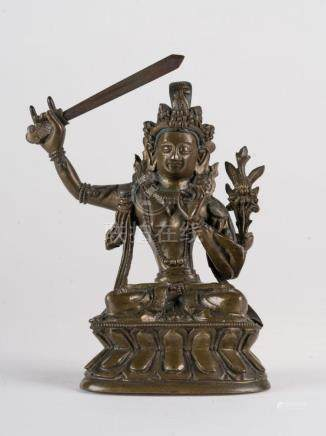 Himalayan Art A dark bronze figure of Manjusri (Wenshu) Chin