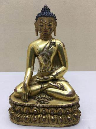 Himalayan Art A gilt bronze figure of seated Aksobya Tibet,