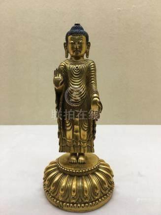 Himalayan Art A gilt bronze figure of standing Udayana Buddh
