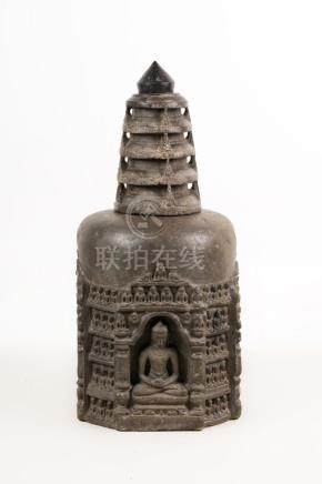 Himalayan Art A dark stone stupa sculpted with Buddha Shakya