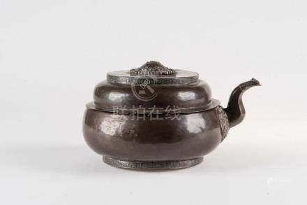 Himalayan Art A copper and silver embossed teapot Tibet, 19t