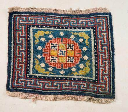 Himalayan Art A Tibetan carpet decorated with flowers and ge