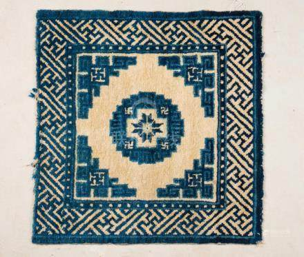 Chinese Art A Ningxia carpet decorated with blue geometrical