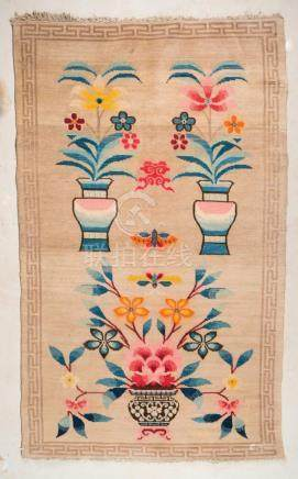 Himalayan Art A Tibetan carpet decorated with vases and flow