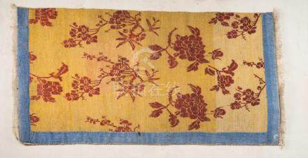 Himalayan Art A Tibetan carpet decorated with red flowers ov