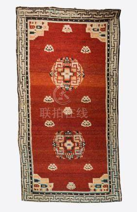 Himalayan Art A Tibetan carpet decorated with geometrical mo