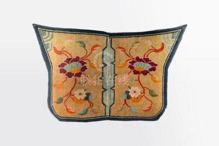 Himalayan Art A saddle carpet decorated with peonies over cr