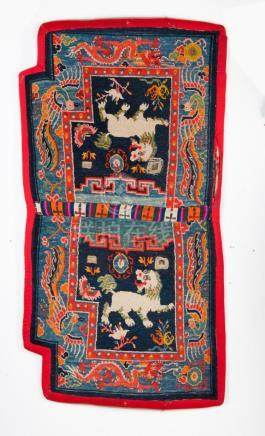 Himalayan Art A saddle carpet decorated with two snow lions