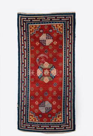 Himalayan Art A red ground carpet decorated with flowers Tib