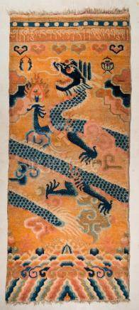 Himalayan Art A Tibetan carpet depicting a blue dragon over