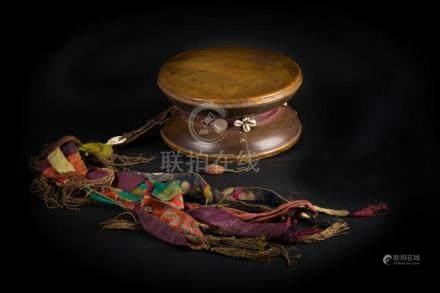 Himalayan Art A large leather and wood damaru drum Tibet, 19