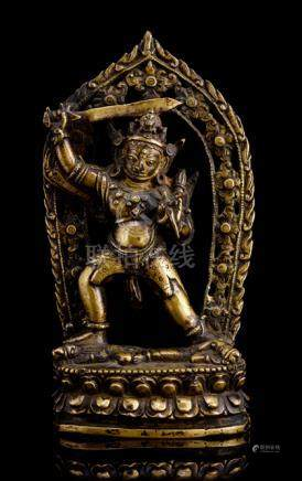 A BRONZE FIGURE OF ACALA, TIBET, 13th/14th ct., trampling in alidhasana on a divinity and elephant l