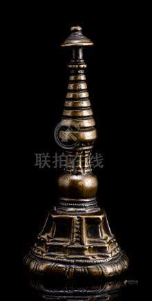 A RARE BRONZE MINIATURE STUPA, TIBET, ca. 12th/13th ct., the stupa placed on a lotus border cast wit