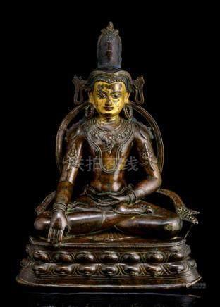 AN IMPORTANT BRONZE FIGURE OF AKSHOBHYA, TIBET, ca. 14th ct., seated in vajrasana on a lotus base wi