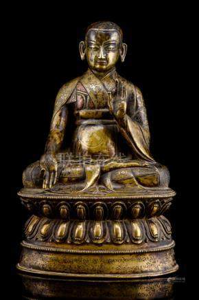 A LARGE AND RARE SILVER- AND COPPER-INLAID BRONZE FIGURE OF SANS.RGYAS.'PHEL, TIBET, early 16th ct.,