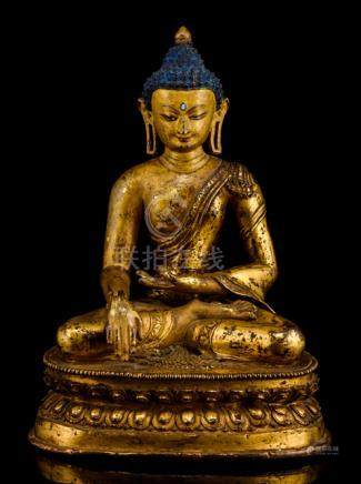 AN FINE GILT-BRONZE FIGURE OF BUDDHA SHAKYAMUNI, TIBET, 15th ct., seated in vajrasana on a lotus bas
