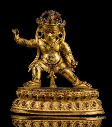 A GILT-BRONZE FIGURE OF HAYAGRIVA, TIBET, 16th ct., standing in alidhasana on a lotus base, both han