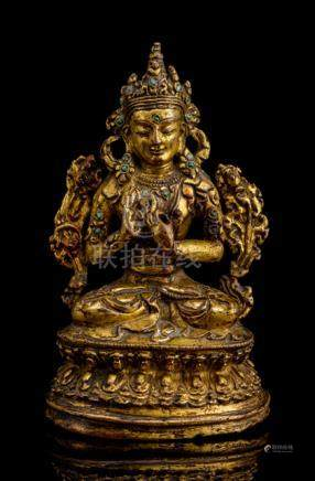A GILT-BRONZE FIGURE OF MAITREYA, TIBET, 16th ct., seated in vajrasana on a lotus base with both han