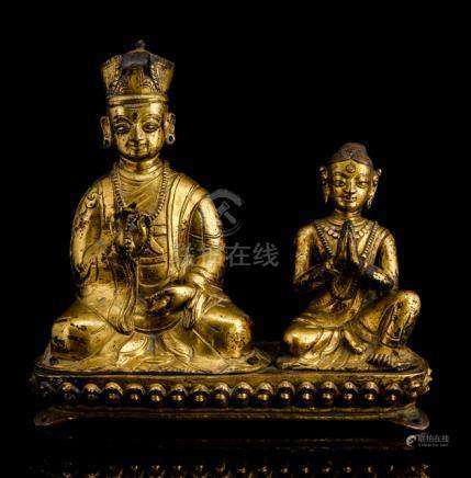 A RARE GILT-BRONZE GROUP OF A KARMAPA LAMA AND A FEMALE DEVOTEE, NEPAL, 18th ct., the lama is seated