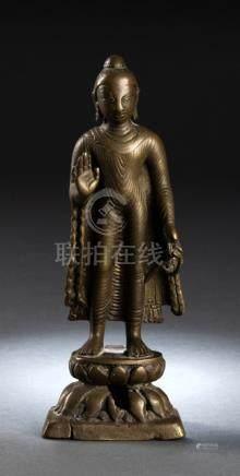 A LOW ALLOY SILVER INLAID BRONZE FIGURE OF BUDDHA SHAKYAMUNI, KASHMIR, 7th/8th Ct., standing in slig