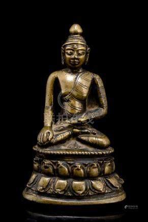 A BRONZE FIGURE OF BUDDHA SHAKYAMUNI, TIBET, 12th /13th ct., seated in vajrasana on a lotus base wit
