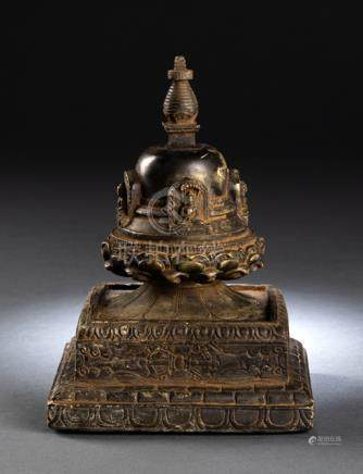 A STONE STUPA, NEPAL, 15th/16th ct., the stupa consists of a tiered square base, its sides carved wi
