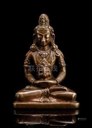 A BRONZE FIGURE OF AMITAYUS, CHINA, 18th ct., seated in vajrasana on a plinth with both hands in dhy