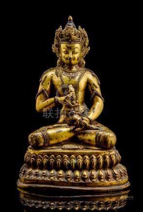 A GILT-BRONZE FIGURE OF VAJRASATTVA, NEPAL, ca. 18th ct., seated in vajrasana on a lotus base, the h