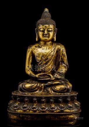 A BRONZE FIGURE OF BUDDHA SHAKYAMUNI, CHINA, probably Ming dynasty, seated in vajrasana on a lotus b