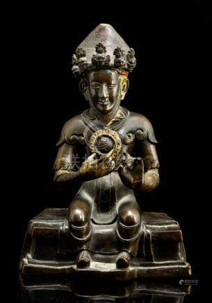 A RARE BRONZE FIGURE OF TEACHER, TIBET, 18th/19th ct., seated in bhadrasana on a throne with both ha