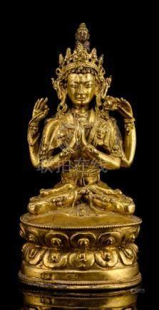 A GILT-BRONZE FIGURE OF SADAKSHARILOKESHVARA, TIBET, CA. 17th ct., seated in vajrasana on a lotus ba