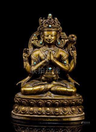 A BRONZE FIGURE SADAKSHARILOKESHVARA, TIBET, 15th ct., seated in vajrasana on a lotus base with his