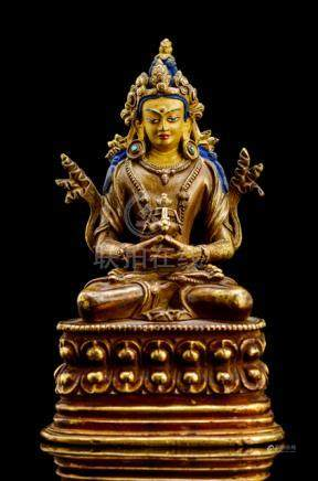 A BRONZE FIGURE OF AMITAYUS, TIBET, 17th ct., seated in vajrasana on a lotus base with both hands in