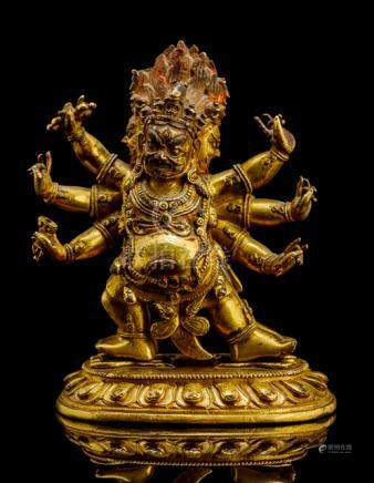 A GILT-BRONZE FIGURE OF HAYAGRIVA, TIBETO-CHINESE, 18th ct., standing in alidhasana on snakes curlin