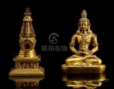 A GILT-BRONZE FIGURE OF AMITAYUS AND A GILT-BRONZE STUPA, TIBETO-CHINESE, 18th ct., Amitayus is seat