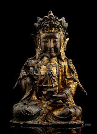 A GILT-LACQUERED BRONZE FIGURE OF GUANYIN, CHINA, 17th ct., seated in vajrasana with the right hand