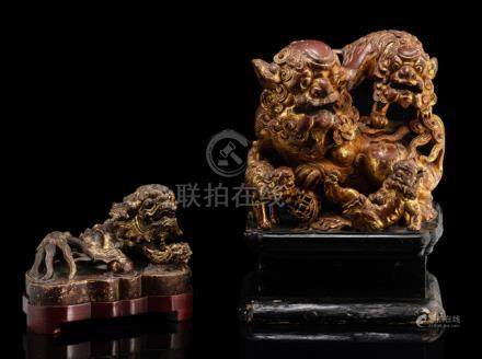 TWO WOOD AND STONEWARE CARVINGS OF FO LIONS, China, Qing dynasty - Formerly property from the collec