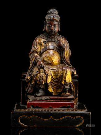 A PARCEL GILT-LACQUER AND POLYCHROME WOOD FIGURE OF PROBABLY GUANDI, CHINA, 18th ct., seated in Euro