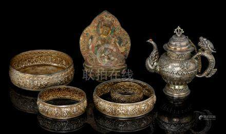 A LOW-ALLOY SILVER RICE MANDALA AND AN EWER AND A PAINTED TSHA TSHA, Tibet, 18th ct. and later - Pro