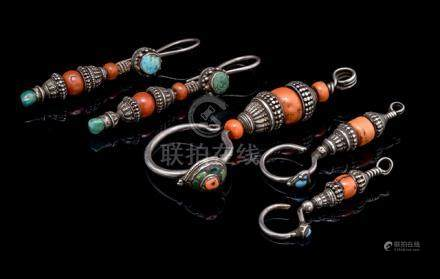 A PAIR OF SILVER AND RED CORAL EAR-RINGS AND THREE SINGLE EAR-RINGS, TIBET, 20th ct., all ear-rings