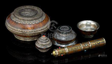 TWO BOWLS AND COVERS, A COPPER CONTAINER AND TWO BOWLS, partly decorated with silver, Tibet, ca. 190
